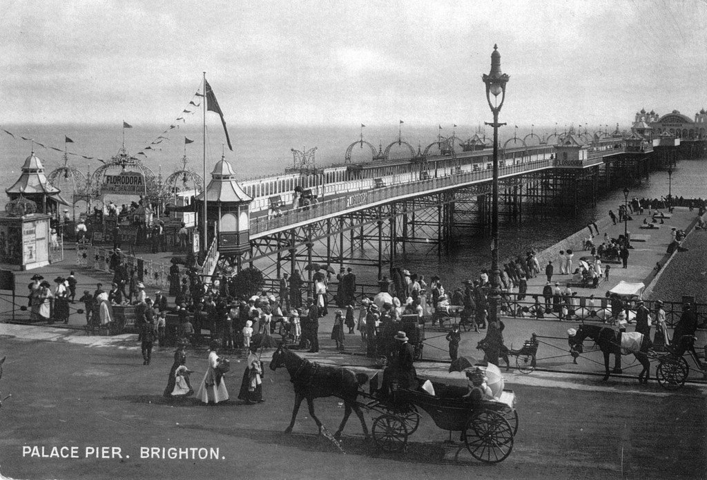 Horse and carriage the Palace Pier, Brighton by unkown